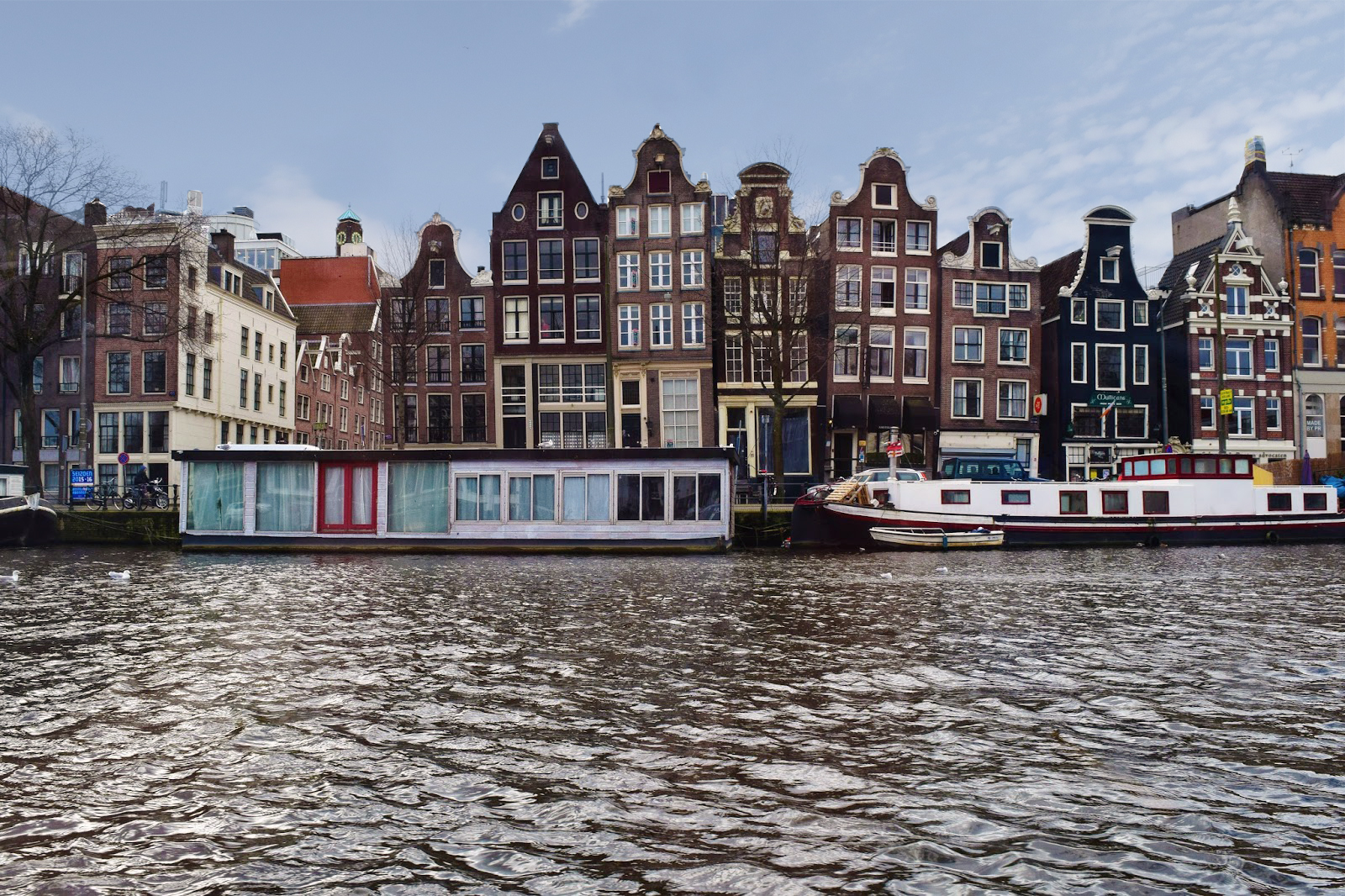Looking across canal in Amsterdam towards tall thin wonky dutch houses.