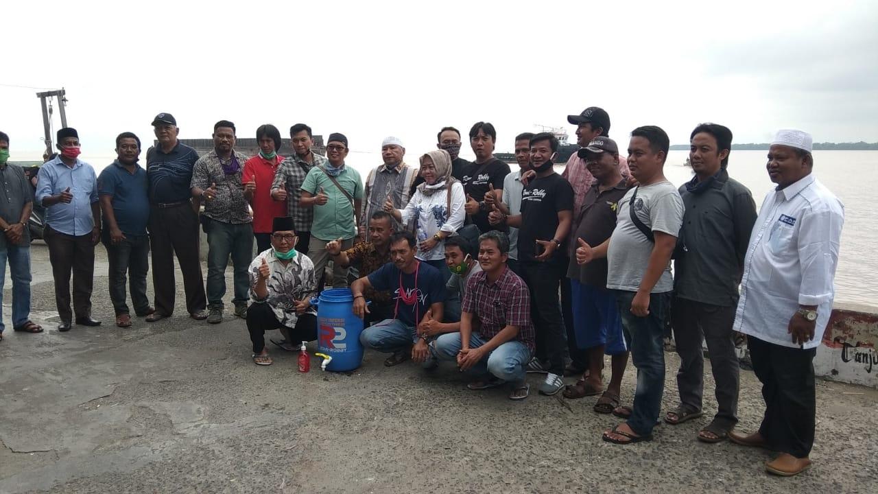 Team R2 dan Relawan Bagikan Ribuan Masker Ke Masyarakat Kuala Jambi