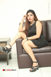 Tollywood Upcoming Actress Pooja Roshan Stills in Black Short Dress at Plus 1 Movie Trailer Launch  0339.JPG
