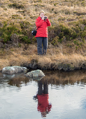 Photo of me with my camera by a Glencoe loch