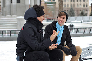 Being a witness naturally - two fellows relaxed, talking outside on a winter day
