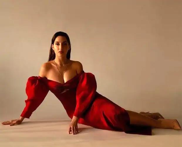Nora Fatehi sets internet on fire in a red off shoulder dress