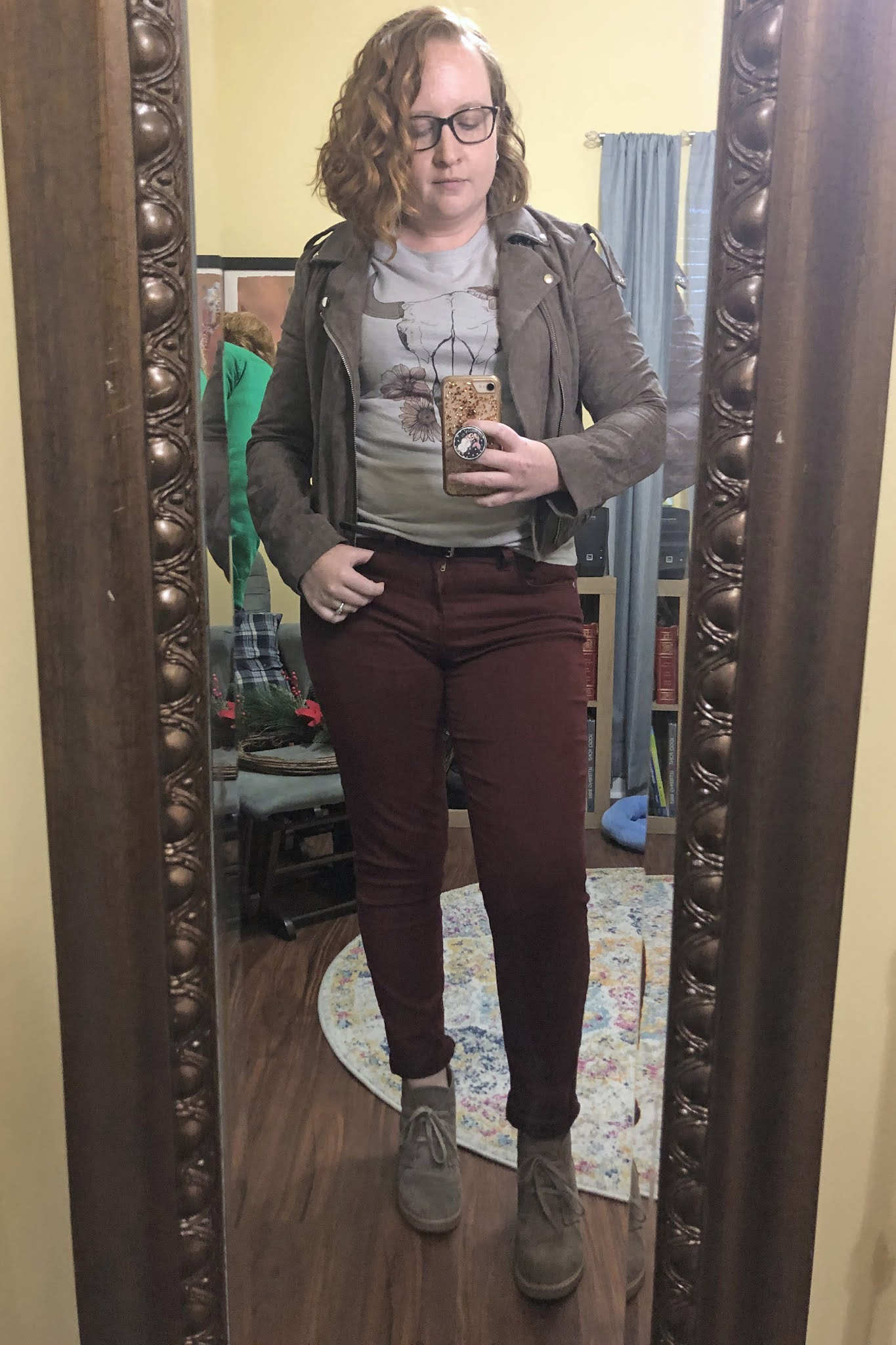 grey moto jacket graphic tee maroon pants