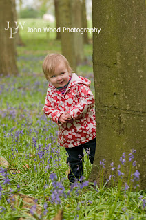 Child playing in bluebell woods