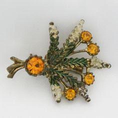 Amber rhinestone Scottish brooch by Exquisite