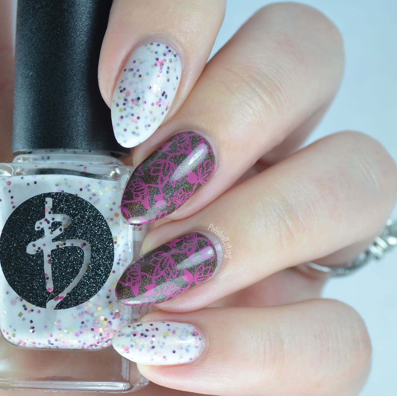 Polished lifting lotus flower mani featuring bliss polish and white crelly polish with chocolate holographic accent and lotus flower stamping izmirmasajfo