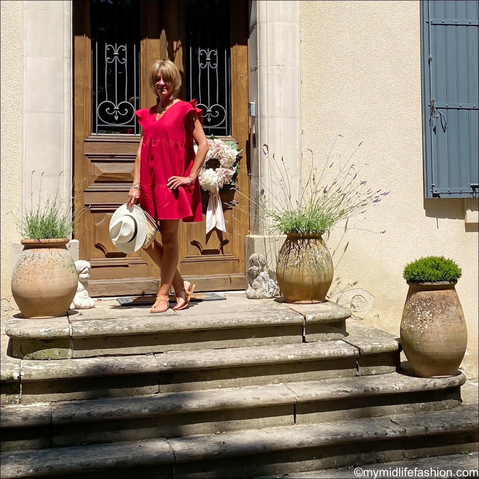 my midlife fashion, initially London Ibiza Clutch, Carvela sandals, zara Panama hat, riyka ceres red linen tiered dress