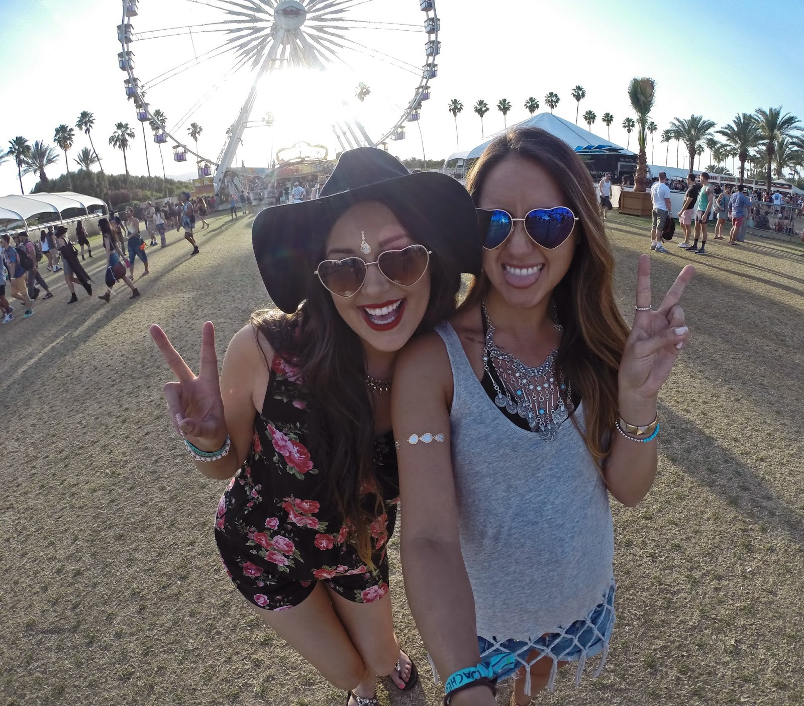 Fashion bloggers Mash Elle and Boho Nouveau posing in a selfie with the iconic Coachella ferris wheel - Peace & Love: Coachella Outfits by popular Orlando fashion blogger Mash Elle