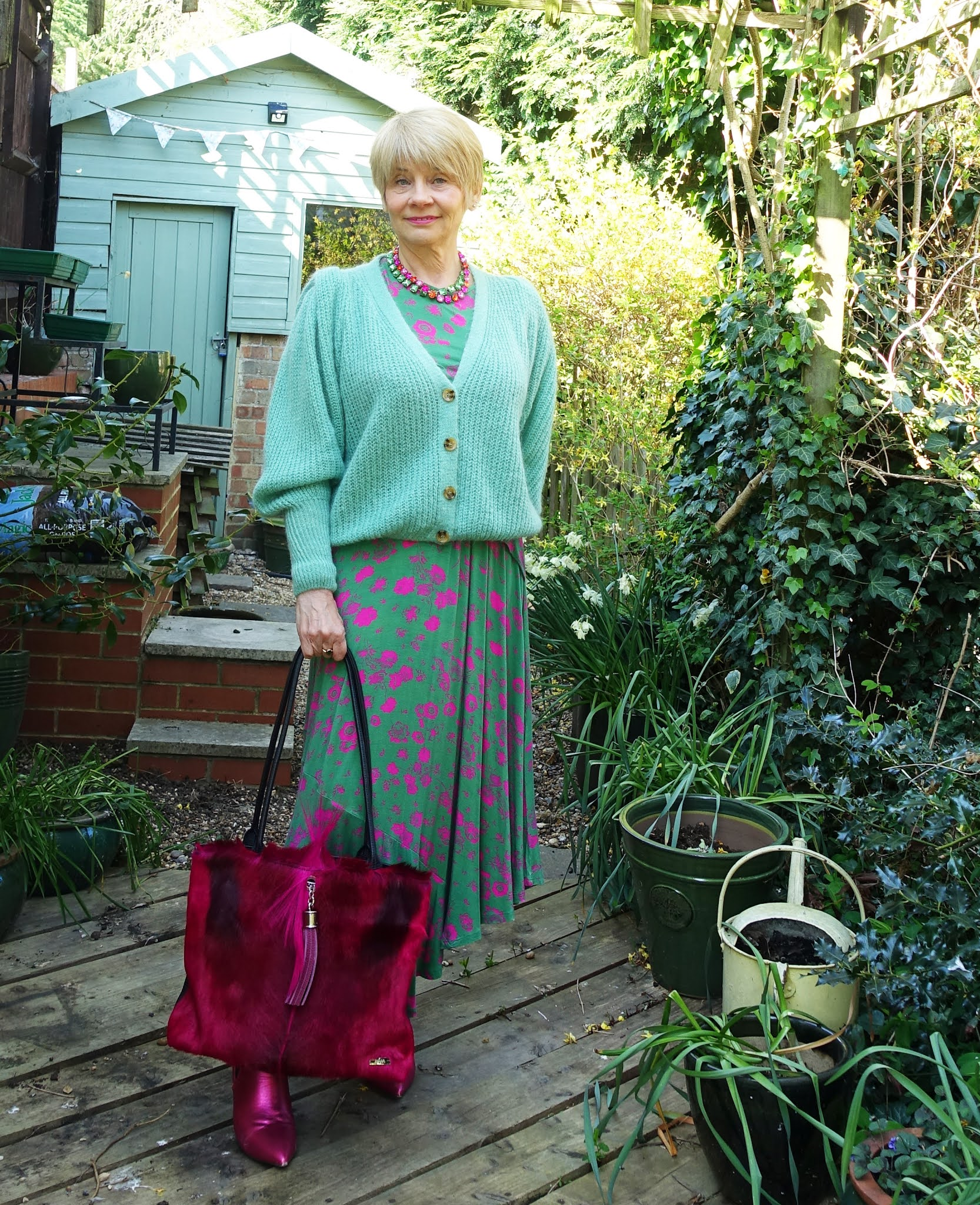 Gail Hanlon from Is This Mutton in green and pink midi dress with mohair green cardigan and pink boots