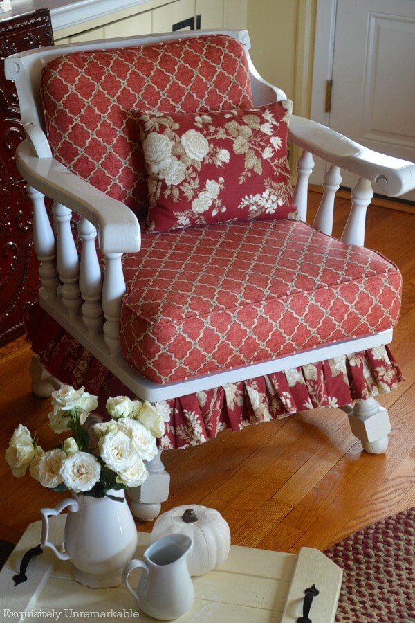 Cottage Style Fabric Chair with rose pillow on seat and fall tray with accessories on floor
