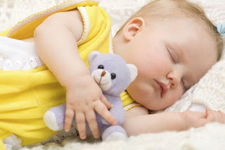 sleeping baby with soft toy