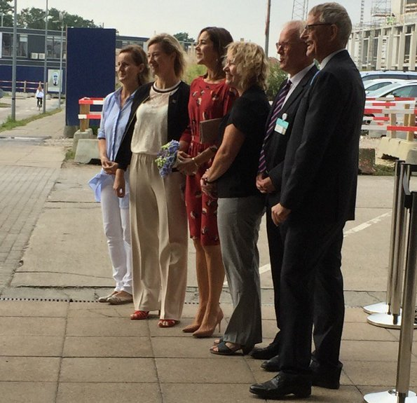 Crown Princess Mary wore a red dress from 'Peper' collection of ba&sh and Gianvito Rossi shoes for visit National Center for Immune Therapy