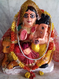 Goddess Parvati with her son Ganesh