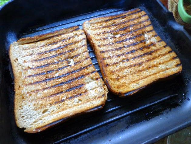 Smear each slice of bread with garlic clove