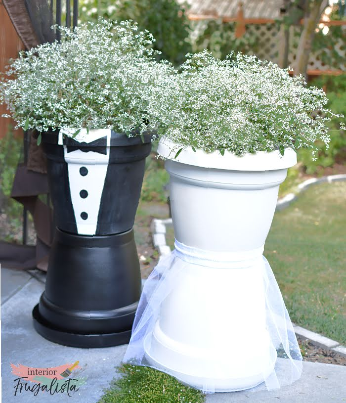 How to make adorable bride and groom flower pots to flank the aisle for an outdoor wedding and can easily be transported to the reception venue later.