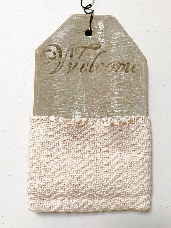 wall pocket with sweater pocket and Welcome sign