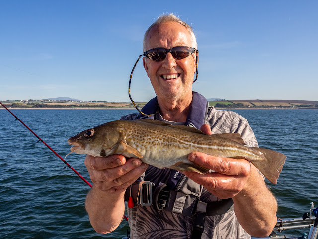 Photo of Phil with the only decent-sized codling he caught on this trip