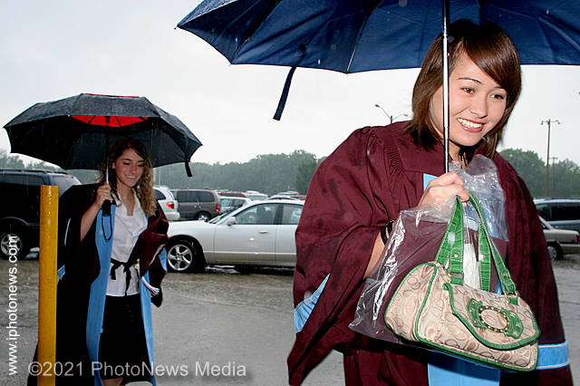 Kimberly Capagalan [right] and Abriel Shipley brave a downpour to get to their graduation ceremony in 2007.