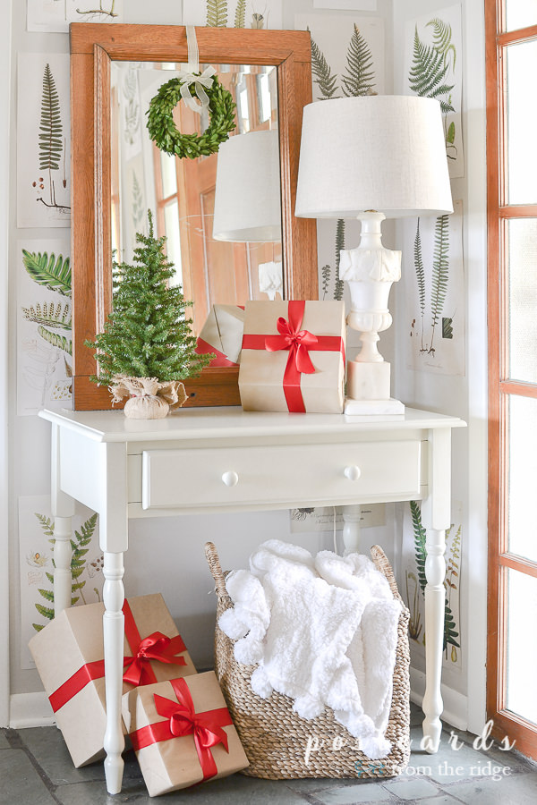 small white desk and wooden mirror with Christmas decorations