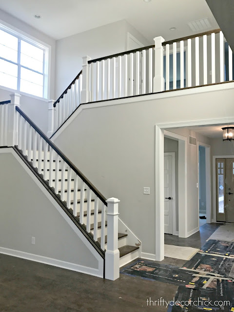 wood stairs, white newel posts, stained hand rails