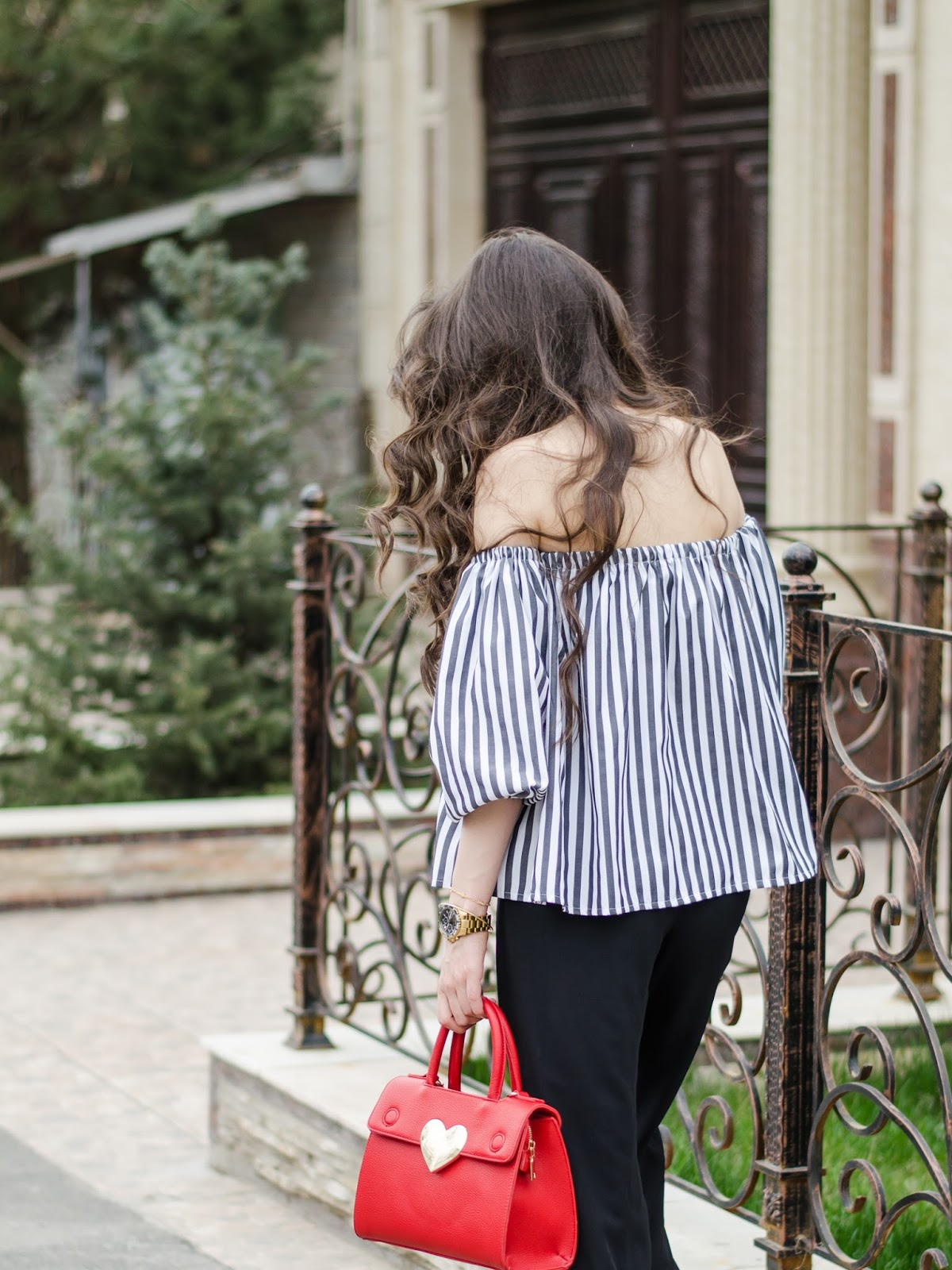 fashion blogger diyorasnotes diyora beta striped offtheshoulder top wide leg pants red bag