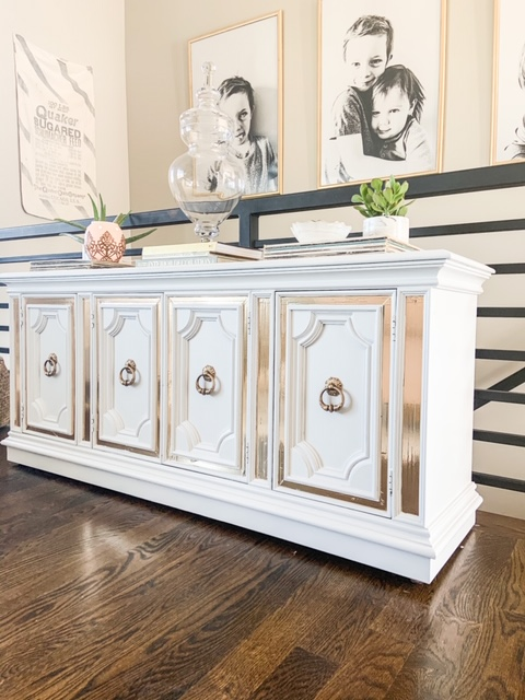 white buffet table with gold hardware and gold inlay