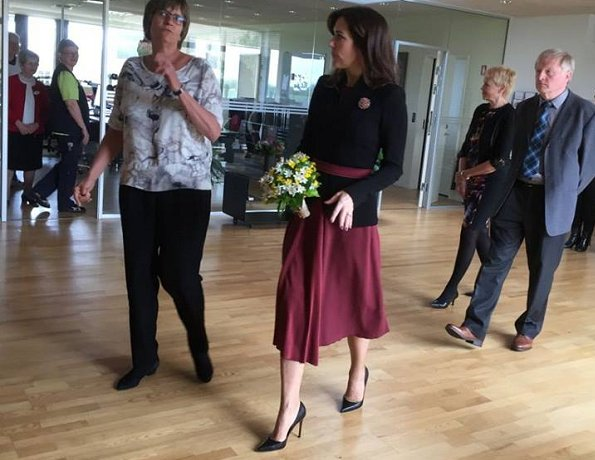 Crown Princess Mary of Denmark visited the Svanevig Hospice in Bandholm, The Crown Princess wore Gianvito Rossi shoes, Prada coat