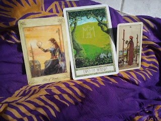 Two of Wands tarot cards from Llewellyn Tarot, copyright Llewellyn, The Druidcraft Deck, by Phillip Carr-Gomm and Stephanie Gomm and the Smith-Waite Centennial Tarot by US Games, photo by Juli D. Revezzo