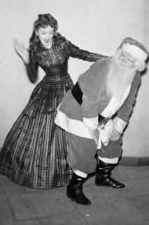 Professional Disciplinarian woman spanking Santa