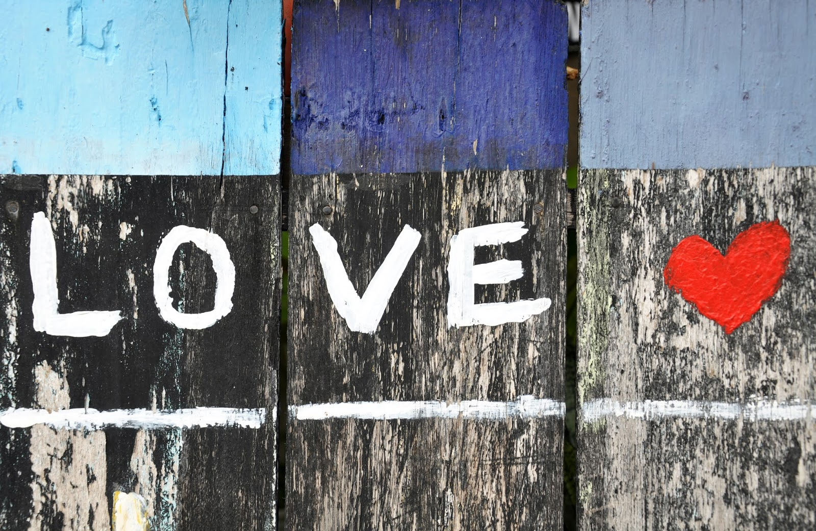 photography of black, white and red love text-printed board, love images