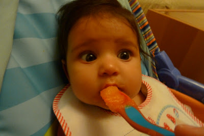 Baby being fed with a puree