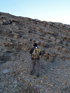 Matt Stimson getting closer to fossil bearing rock