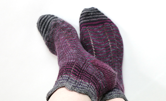 Wearing Socks Knit with Purple Chevron Stripes