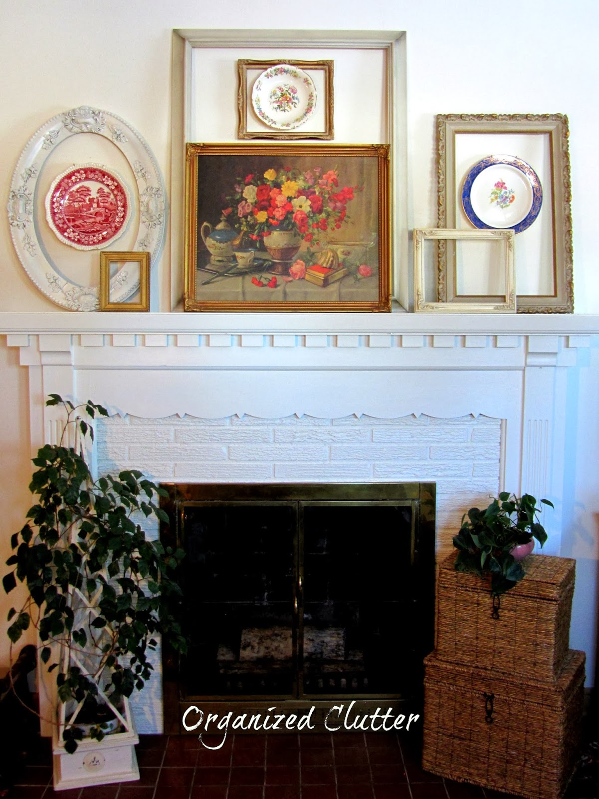 Frames & Plates on the Mantel www.organizedclutterqueen.blogspot.com