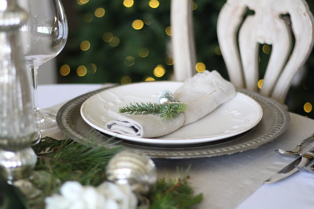 holiday tablescape silver chargers greens hydrangeas linen napkins