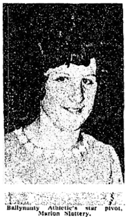 grainy black and white image of a smiling dark-haired woman