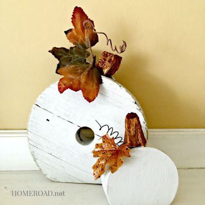 White pumpkins made from repurposed wooden wheels