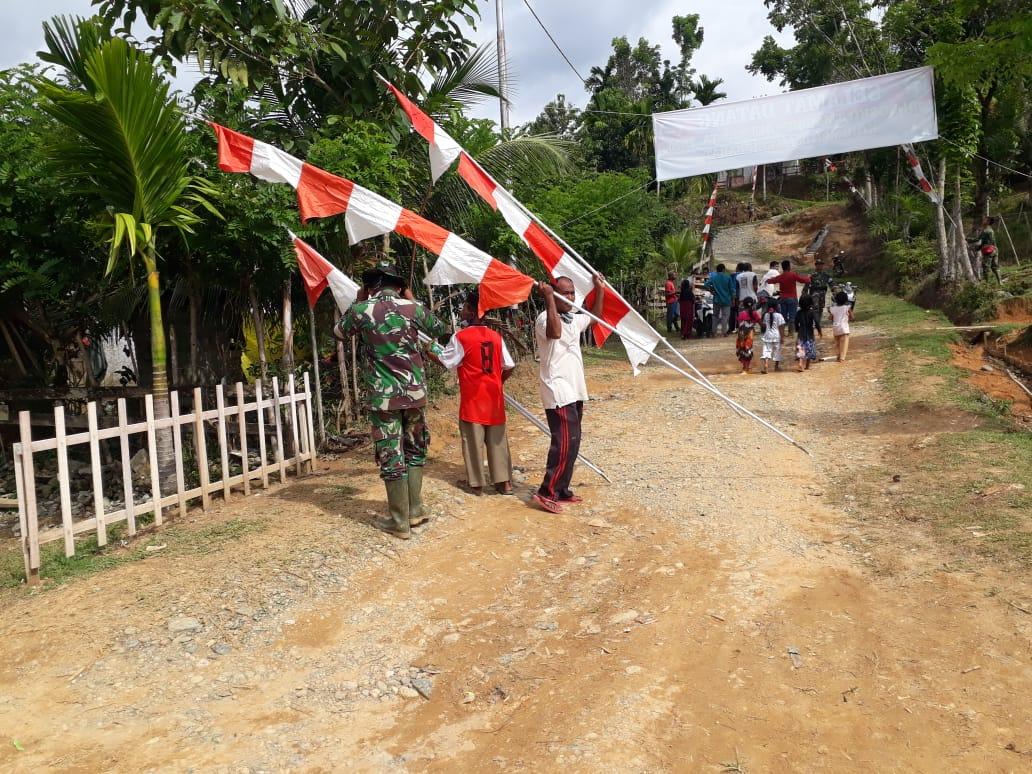 Jelang Penutupan TMMD Ke-108 Dan Menyambut HUT RI Ke-75, Satgas dan Warga Pasang Umbul-Umbul Di Desa Lango