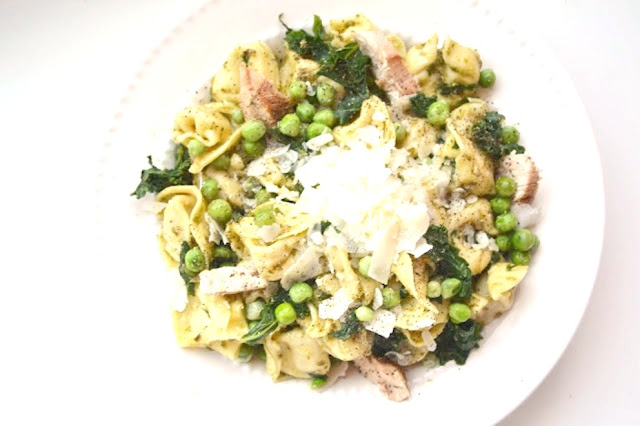 Chicken Pesto Tortellini with Kale and Peas is ready in just 20 minutes and is a flavorful and healthy meal that the whole family will love! www.nutritionistreviews.com