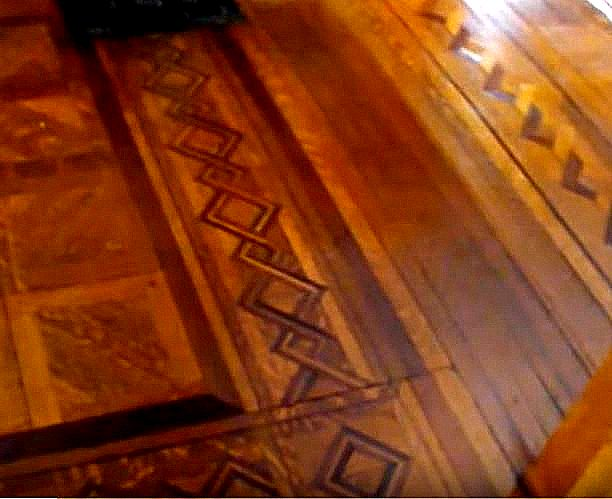 red oak and mahogany pieces hand laid to form parquet floor in vestibule of Webber residence