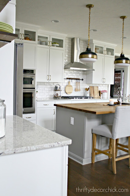 Kitchen with glass cabinets at top