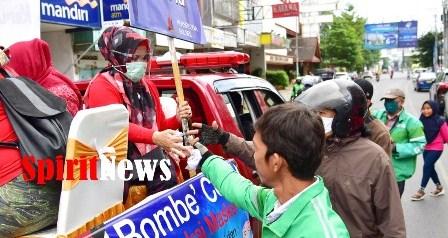 Lies F Nurdin, Keliling Kota Makassar Sosialisasikan Penggunaan Masker