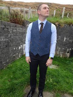 tweed waist coat and brown tie slaters