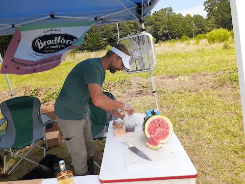 Nat Bradford slicing watermelon