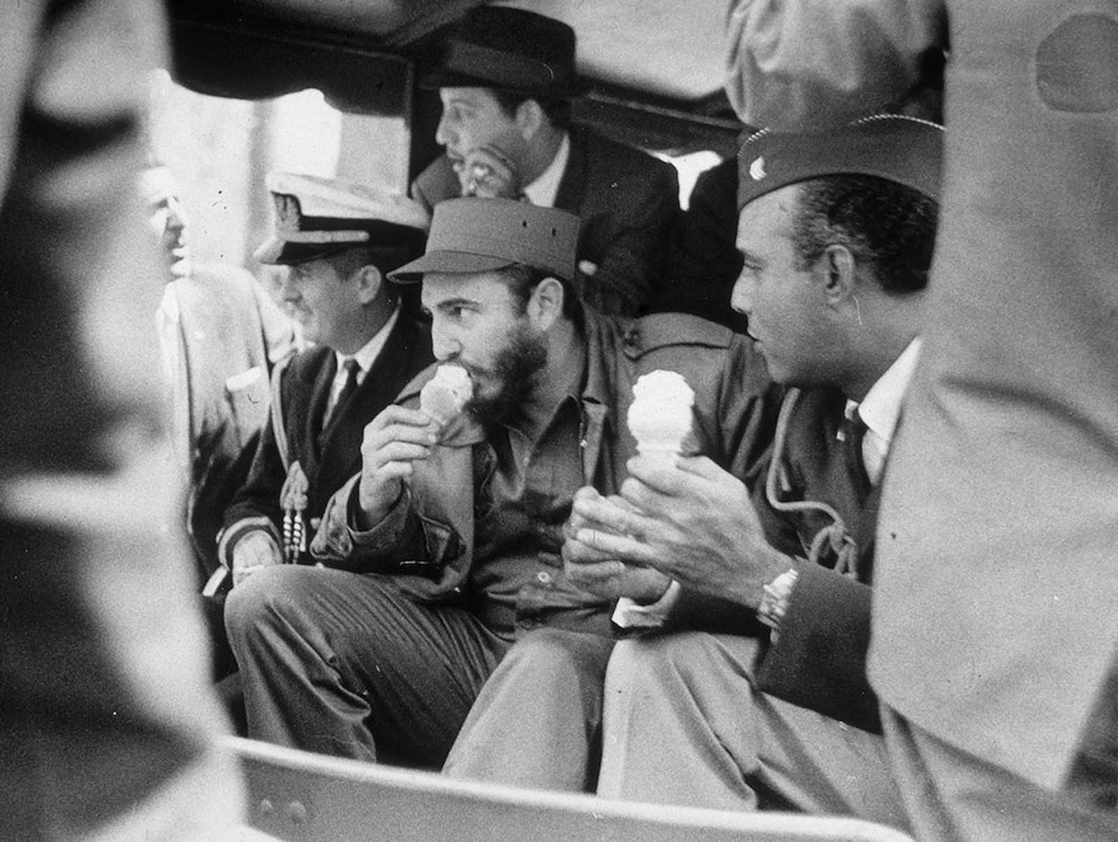 Castro eats an ice cream cone as he rides in the Bronx Zoo train, in New York City.