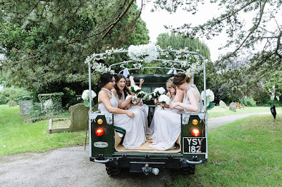 bridesmaids on wedding car
