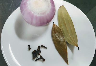 Onion,cloves and Bay leaves for pasta in white sauce recipe