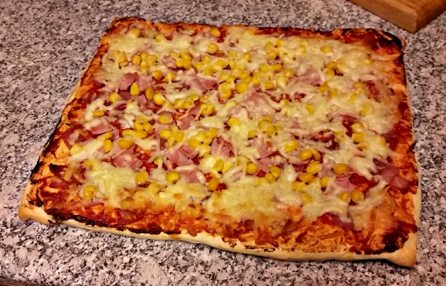 The made pizza ready to be cut.