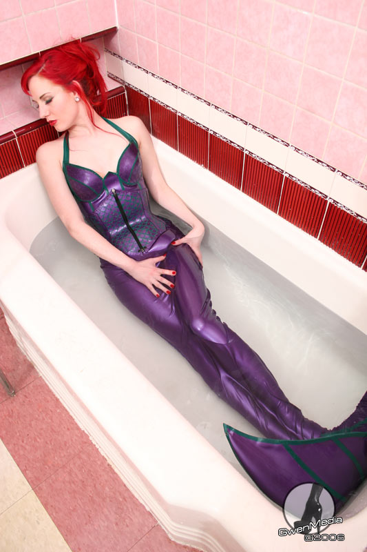 Latex mermaid bondage