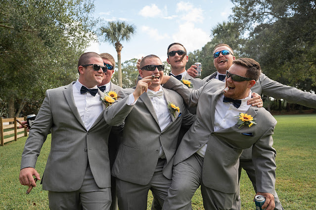Groomsmen pumping up Groom with cigars and beer Magnolia Manor Wedding Photos by Stuart Wedding Photographer Heather Houghton Photography